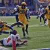 West Virginia\' Ishmael Banks (34) reaches over the goal line for touchdown after returning an interction 58-yard for the score during the first quarter of an NCAA college football game Oklahoma State in Morgantown, W.Va., on Saturday, Sept. 28, 2013. (AP Photo/Tyler Evert)