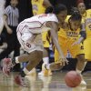 Oklahoma\'s Sharane Campbell, left, and Central Michigan\'s Crystal Bradford chase a loose ball during the first half of a first-round game in the women\'s NCAA college basketball tournament Saturday, March 23, 2013, in Columbus, Ohio. (AP Photo/Jay LaPrete) ORG XMIT: OHJL103