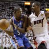 Oklahoma City\'s Kevin Durant (35) looks to pass around Miami\'s Chris Bosh (1) during Game 3 of the NBA Finals between the Oklahoma City Thunder and the Miami Heat at American Airlines Arena, Sunday, June 17, 2012. Photo by Bryan Terry, The Oklahoman
