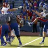 OU\'s Matt Dimon (90) and OU\'s Londell Taylor (31) leap forward as OU blocks the punt of KU\'s Trevor Pardula (16)during the college football game between the University of Oklahoma Sooners (OU) and the University of Kansas Jayhawks (KU) at Memorial Stadium in Lawrence, Kan., Saturday, Oct. 19, 2013. Photo by Bryan Terry, The Oklahoman