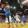 Photo - Oklahoma City Thunder forward Kevin Durant, left, puts up a shot against the Houston Rockets during an NBA basketball game in Houston Friday, April 4, 2014.   (AP Photo/Richard Carson)