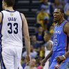 Oklahoma City\'s Kevin Durant (35) celebrates beside Memphis\' Marc Gasol (33) after a dunk during Game 6 in the first round of the NBA playoffs between the Oklahoma City Thunder and the Memphis Grizzlies at FedExForum in Memphis, Tenn., Thursday, May 1, 2014. Oklahoma City won 104-84. Photo by Bryan Terry, The Oklahoman