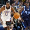 Oklahoma City\'s James Harden (13) takes the ball on a fast break in front of Ian Mahinmi (28) of Dallas in the first half of an NBA basketball game between the Oklahoma City Thunder and the Dallas Mavericks at Chesapeake Energy Arena in Oklahoma City, Thursday, Dec. 29, 2011. Photo by Nate Billings, The Oklahoman