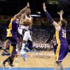 Oklahoma City\'s Russell Westbrook (0) goes to the basket between Los Angeles\' Kobe Bryant (24) and Pau Gasol (16) during Game 2 in the second round of the NBA playoffs between the Oklahoma City Thunder and L.A. Lakers at Chesapeake Energy Arena in Oklahoma City, Wednesday, May 16, 2012. Oklahoma City won 77-75. Photo by Bryan Terry, The Oklahoman