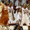 Oklahoma\'s Romero Osby (24) reacts near Amath M\'Baye (22) and Texas\' Ioannis Papapetrou (33) after making a basket and being fouled during a men\'s college basketball game between the University of Oklahoma (OU) and the University of Texas at the Lloyd Noble Center in Norman, Okla., Monday, Jan. 21, 2013. Photo by Nate Billings, The Oklahoman