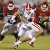 Oklahoma\'s Trevor Knight (9) runs during a college football game between the University of Oklahoma Sooners (OU) and the Louisiana Tech Bulldogs at Gaylord Family-Oklahoma Memorial Stadium in Norman, Okla., on Saturday, Aug. 30, 2014. Photo by Bryan Terry, The Oklahoman