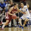 Oklahoma\'s Morgan Hook, left, dribbles upcourt as UCLA\'s Mariah Williams defends during the first half of a second-round game in the women\'s NCAA college basketball tournament, Monday, March 25, 2013, in Columbus, Ohio. (AP Photo/Jay LaPrete) ORG XMIT: OHJL104
