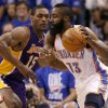 Oklahoma City\'s James Harden (13) tries to get past Los Angeles\' Metta World Peace (15) during Game 1 in the second round of the NBA playoffs between the Oklahoma City Thunder and L.A. Lakers at Chesapeake Energy Arena in Oklahoma City, Monday, May 14, 2012. Photo by Bryan Terry, The Oklahoman