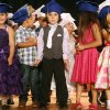 Photo -  Led by graduate Roman Body, center, the class sings and dances during a pre-K graduation ceremony for Heronville Elementary held at Capitol Hill High School.   <strong>KT King -   </strong>
