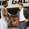 OSU head coach Travis Ford talks with Kirby Gardner (1) during a men\'s college basketball between Oklahoma State University and Missouri State at Gallagher-Iba Arena in Stillwater, Okla., Saturday, Dec. 8, 2012. OSU won, 62-42. Photo by Nate Billings, The Oklahoman