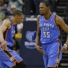 Oklahoma City\'s Kevin Durant (35) and Russell Westbrook (0) celebrate after a dunk during Game 6 in the first round of the NBA playoffs between the Oklahoma City Thunder and the Memphis Grizzlies at FedExForum in Memphis, Tenn., Thursday, May 1, 2014. Oklahoma City won 104-84. Photo by Bryan Terry, The Oklahoman