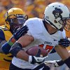 Oklahoma State receiver Charlie Moore (17) is tackled by West Virginia defender Isaiah Bruce (31) after a failed flea flicker in the third quarter of an NCAA college football game in Morgantown, W.Va., on Saturday, Sept. 28, 2013. (AP Photo/Tyler Evert)