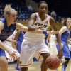 Oklahoma State\'s Toni Young, right, and DePaul\'s Katherine Harry (51) chase a loose ball during the second half of a first-round game in the women\'s NCAA college basketball tournament in Durham, N.C., Sunday March 24, 2013. Oklahoma State won 73-56. (AP Photo/Gerry Broome) ORG XMIT: NCGB119