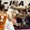 Oklahoma State\'s Markel Brown (22) passes away from Texas\' Demarcus Holland (2) during a men\'s college basketball game between Oklahoma State University (OSU) and the University of Texas at Gallagher-Iba Arena in Stillwater, Okla., Saturday, March 2, 2013. Photo by Nate Billings, The Oklahoman