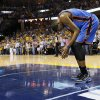 Oklahoma City\'s Kevin Durant (35) leans over and pauses before walking to the bench when a timeout is called in the final minute of Game 3 in the second round of the NBA basketball playoffs between the Oklahoma City Thunder and Memphis Grizzles at the FedExForum in Memphis, Tenn., Saturday, May 11, 2013. Memphis won, 87-81. Photo by Nate Billings, The Oklahoman