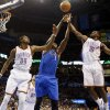From left, Oklahoma City\'s Kevin Durant (35), Dallas\' Samuel Dalembert (1) and Oklahoma City\'s Reggie Jackson (15) try to rebound the ball during an NBA basketball game between the Oklahoma City Thunder and the Dallas Mavericks at Chesapeake Energy Arena in Oklahoma City, Sunday, March 16, 2014. Dallas won, 109-86. Photo by Nate Billings, The Oklahoman