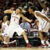 Photo - From left, Oklahoma's Gioya Carter (25), Nicole Kornet (1), Kaylon Williams (42) and Sharane Campbell (24) celebrate in the bench area after a 3-point basket by Aaryn Ellenberg (not pictured) during a women's college basketball game between the Oklahoma Sooners and Texas Tech at Lloyd Noble Center in Norman, Okla., Monday, March 3, 2014. OU won 87-32. Photo by Nate Billings, The Oklahoman