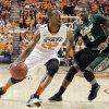 Oklahoma State \'s Markel Brown (22) drives past South Florida Bulls\' Jawanza Poland (5) during the college basketball game between Oklahoma State University (OSU) and the University of South Florida (USF) on Wednesday , Dec. 5, 2012, in Stillwater, Okla. Photo by Chris Landsberger, The Oklahoman