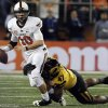 Photo -  Missouri defensive lineman Kony Ealy (47) sacks Oklahoma State quarterback Clint Chelf (10) during the first half of the Cotton Bowl NCAA college football game on Friday, Jan. 3, 2014, in Arlington, Texas. (AP Photo/Brandon Wade)