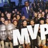 Kevin Durant poses for a photo with kids from the Oklahoma City Boys and Girls club during a news conference announcing Durant as the winner of the 2013-14 Kia NBA Basketball Most Value Player Award in Oklahoma City, Okla. on Tuesday, May 6, 2014. Photo by Chris Landsberger, The Oklahoman