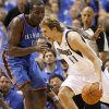 Dallas\' Dirk Nowitzki (41) goes past Oklahoma City\'s Kendrick Perkins (5) during Game 3 of the first round in the NBA playoffs between the Oklahoma City Thunder and the Dallas Mavericks at American Airlines Center in Dallas, Thursday, May 3, 2012. Photo by Bryan Terry, The Oklahoman