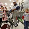 Kevin Durant of the Oklahoma City Thunder tries out a bicycle while shopping with Ryan Joy, 9, left, and Cadyn Joy, 6, during the Oklahoma City Thunder\'s annual Holiday Assist shopping spree at Target, 13924 N Pennsylvania, in Oklahoma City, Monday, Dec. 10, 2012. The ten families who participated in this year\'s shopping spree are from Sunbeam Family Services\' Grandparents Raising Grandchildren program. Photo by Nate Billings, The Oklahoman