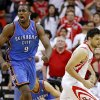 Oklahoma City\'s Serge Ibaka (9) reacts next to Houston\'s Carlos Delfino (10) during Game 3 in the first round of the NBA playoffs between the Oklahoma City Thunder and the Houston Rockets at the Toyota Center in Houston, Texas, Sat., April 27, 2013. Oklahoma City 104-101. Photo by Bryan Terry, The Oklahoman