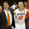 OSU head coach Travis Ford stands with Phil Forte (10) for the singing of the alma mater after a men\'s college basketball game between Oklahoma State University and Texas Tech at Gallagher-Iba Arena in Stillwater, Okla., Saturday, Jan. 19, 2013. OSU won, 79-45. Photo by Nate Billings, The Oklahoman