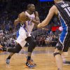 Oklahoma City Thunder\'s Kevin Durant (35) takes the ball to the hoop against Orlando Magic\'s Maurice Harkless (obscured) and Beno Udrih (19) during the second half of an NBA basketball game on Friday, March 22, 2013, in Orlando, Fla. The Thunder won 97-89. (AP Photo/Willie J. Allen Jr.) ORG XMIT: FLWA107