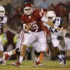 Oklahoma\'s Blake Bell (10) runs on his first play during a college football game between the University of Oklahoma Sooners (OU) and the West Virginia University Mountaineers at Gaylord Family-Oklahoma Memorial Stadium in Norman, Okla., on Saturday, Sept. 7, 2013. Photo by Bryan Terry, The Oklahoman