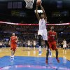 Oklahoma City\'s Kevin Durant (35) dunks between Los Angeles Clippers\' J.J. Redick (4) and DeAndre Jordan (6) during an NBA basketball game between the Oklahoma City Thunder and the Los Angeles Clippers at Chesapeake Energy Arena in Oklahoma City, Thursday, Nov. 21, 2013. Oklahoma City won 105-91. Photo by Bryan Terry, The Oklahoman