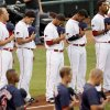 MINOR LEAGUE BASEBALL: Players stand during the national anthem before the 2012 opening day baseball game between the Oklahoma City RedHawks and the Memphis Redbirds at the Chickasaw Bricktown Ballpark in Oklahoma City, Thursday, April 5, 2012. Photo by Nate Billings, The Oklahoman