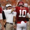 Oklahoma coach Bob Stoops celebrates with OU\'s Blake Bell (10) after a touchdown during the Red River Rivalry college football game between the University of Oklahoma (OU) and the University of Texas (UT) at the Cotton Bowl in Dallas, Saturday, Oct. 13, 2012. Photo by Bryan Terry, The Oklahoman