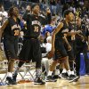 Antonio Fortune (30), Paterick McKaufman (15) and Aaron McKinney (32) react as the Douglass Trojans win 79-70 during the 4A boys semifinal game between the Douglass High School Trojans and Victory Christian\'s Conquorers at the State Fair Arena on Friday, March 8, 2013 in Oklahoma City, Okla. Photo by Steve Sisney, The Oklahoman