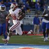 OU\'s Damien Williams (26) scores a touchdown in the fourth quarter beside KU\'s Dexter McDonald (12) and Keon Stowers (98) during the college football game between the University of Oklahoma Sooners (OU) and the University of Kansas Jayhawks (KU) at Memorial Stadium in Lawrence, Kan., Saturday, Oct. 19, 2013. Oklahoma won 34-19. Photo by Bryan Terry, The Oklahoman