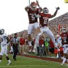 Photo - Oklahoma's Trevor Knight (9), Jalen Saunders (8), and Lacoltan Bester (11) celebrate a touchdown beside Louisiana Monroe's Cordero Smith (10) during a college football game between the University of Oklahoma Sooners (OU) and the University of Louisiana Monroe Warhawks at Gaylord Family-Oklahoma Memorial Stadium in Norman, Okla., on Saturday, Aug. 31, 2013. Photo by Bryan Terry The Oklahoman