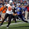 Oklahoma State\'s Justin Blackmon (81) is brought down by Kansas\' Tyler Patmon (33) during the college football game between Oklahoma State (OSU) and Kansas (KU), Saturday, Nov. 20, 2010 at Memorial Stadium in Lawrence, Kan. Photo by Sarah Phipps, The Oklahoman