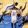 Memphis\' Mike Miller (13) signals for no basket as Oklahoma City\'s Serge Ibaka (9), Reggie Jackson (15) and Thabo Sefolosha (25) celebrate a possible game-wining shot by Ibaka at the end of overtime near Memphis\' Tayshaun Prince (21) during Game 5 in the first round of the NBA playoffs between the Oklahoma City Thunder and the Memphis Grizzlies at Chesapeake Energy Arena in Oklahoma City, Tuesday, April 29, 2014. Instant replay showed Ibaka\'s shot came after the buzzer. Memphis won 100-99 in overtime. Photo by Nate Billings, The Oklahoman