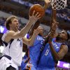 Dallas\' Dirk Nowitzki (41) goes to the basket beside Oklahoma City\'s Serge Ibaka (9) and Nazr Mohammed (8) during Game 4 of the first round in the NBA playoffs between the Oklahoma City Thunder and the Dallas Mavericks at American Airlines Center in Dallas, Saturday, May 5, 2012. Oklahoma City won 103-97. Photo by Bryan Terry, The Oklahoman