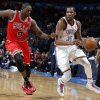 Oklahoma City\'s Kevin Durant (35) tries to get past Chicago\'s Luol Deng (9) during the NBA game between the Oklahoma City Thunder and the Chicago Bulls at Chesapeake Energy Arena in Oklahoma City, Saturday, Feb. 23, 2013. Photo by Sarah Phipps, The Oklahoman