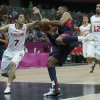 USA\'s Russell Westbrook, center, drives to the basket against Tunisia\'s Mourad El Mabrouk, left, during a men\'s basketball game at the 2012 Summer Olympics, Tuesday, July 31, 2012, in London. (AP Photo/Charles Krupa) ORG XMIT: OBKO171