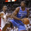 NBA BASKETBALL: Oklahoma City\'s Serge Ibaka (9) grabs the ball beside Miami\'s Chris Bosh (1) during Game 4 of the NBA Finals between the Oklahoma City Thunder and the Miami Heat at American Airlines Arena, Tuesday, June 19, 2012. Photo by Bryan Terry, The Oklahoman
