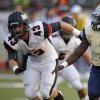 Southmoore\'s Jaleon Walker goes past Westmoore\'s Jacob Tilley during their high school football game in Moore, Okla., Friday, Sept. 13, 2013. Photo by Bryan Terry, The Oklahoman
