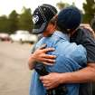 Black Forest Fire evacuee Cindy Miller, left, hugs her husband Ray before he checks on their property with an El Paso County Sheriff's escort in Colorado Springs, Colo. on Friday, June 14, 2013. The Millers lost their house in the fire. (AP Photo/The Denver Post, Hyoung Chan) MAGS OUT; TV OUT; INTERNET OUT; NO SALES; NEW YORK POST OUT; NEW YORK DAILY NEWS OUT
