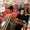 A sea of people gather near the electronics section at Target just minutes after the doors open in Muskegon, on Thursday Nov. 22, 2012. (AP Photo/The Chronicle-mlive.com, Libby March)