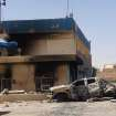 This photo taken on Tuesday, July 1, 2014, shows a burned police station from clashes between fighters of the al-Qaida-inspired Islamic State of Iraq and the Levant and Iraqi security forces in central Tikrit, 80 miles (130 kilometers) north of Baghdad, Iraq. The Islamic State of Iraq and the Levant announced this week that it has unilaterally established a caliphate in the areas under its control. It declared the group's leader, Abu Bakr al-Baghdadi, the head of its new self-styled state governed by Shariah law and demanded that all Muslims pledge allegiance to him. (AP Photo)