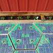 In this May 2014, photo provided by Solar Roadways, a prototype solar-panel parking area stands at the company's business in Sandpoint, Idaho. Scott Brusaw's idea for solar-powered roads has gone viral and raised more than $1.4 million in crowdsourced funding. (AP Photo/Solar Roadways)