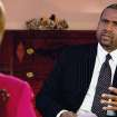 This undated image from video released by PBS shows host Tavis Smiley, right, during an interview with Hillary Rodham Clinton on