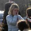 A woman weeps as she arrives to pick up her children at the Sandy Hook Elementary School in Newtown, Conn. where authorities say a gunman opened fire, leaving 27 people dead, including 20 children, Friday, Dec. 14, 2012. (AP Photo/The Journal News, Frank Becerra Jr.) MANDATORY CREDIT, NYC OUT, NO SALES, TV OUT, NEWSDAY OUT; MAGS OUT ORG XMIT: NYWHI106