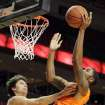 Oklahoma State's Michael Cobbins, right, shoots against Texas Tech's Dusty Hannahs during their NCAA college basketball game, Wednesday, Feb. 13, 2013, in Lubbock, Texas. (AP Photo/The Avalanche-Journal, Zach Long) ALL LOCAL TV OUT